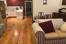 Open plan living area including heating and air-conditioning. Laundry cupboard with washer and dryer.