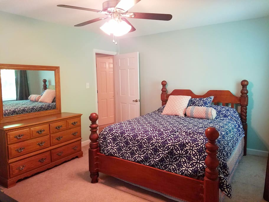 Bedroom #2 with ceiling fan, walk-in closet, extra seating, and crib. Very spacious.