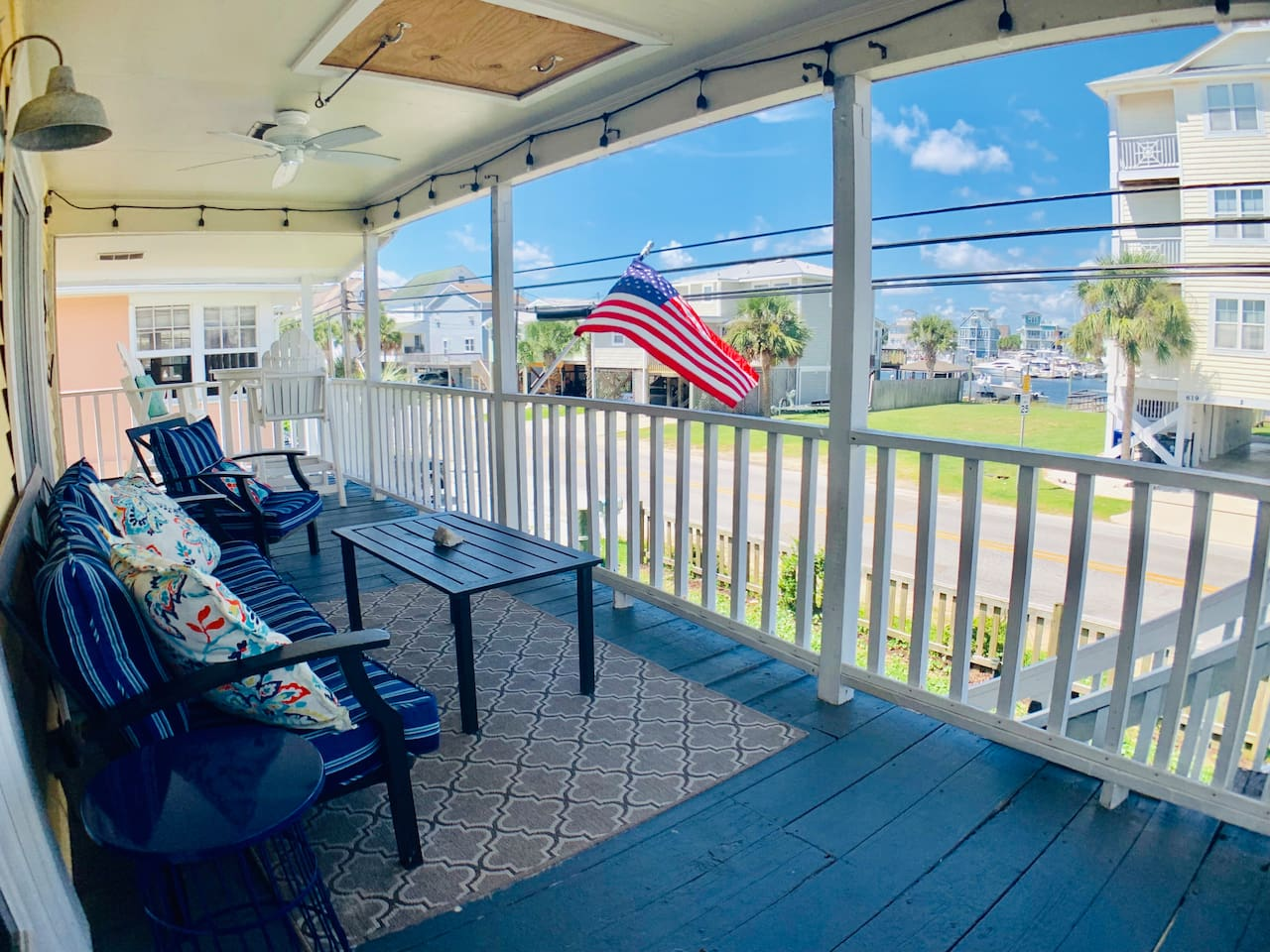 Enjoy views of the canal from the front porch when you come back from your day at the beach,  just 100 yards away with direct beach access!