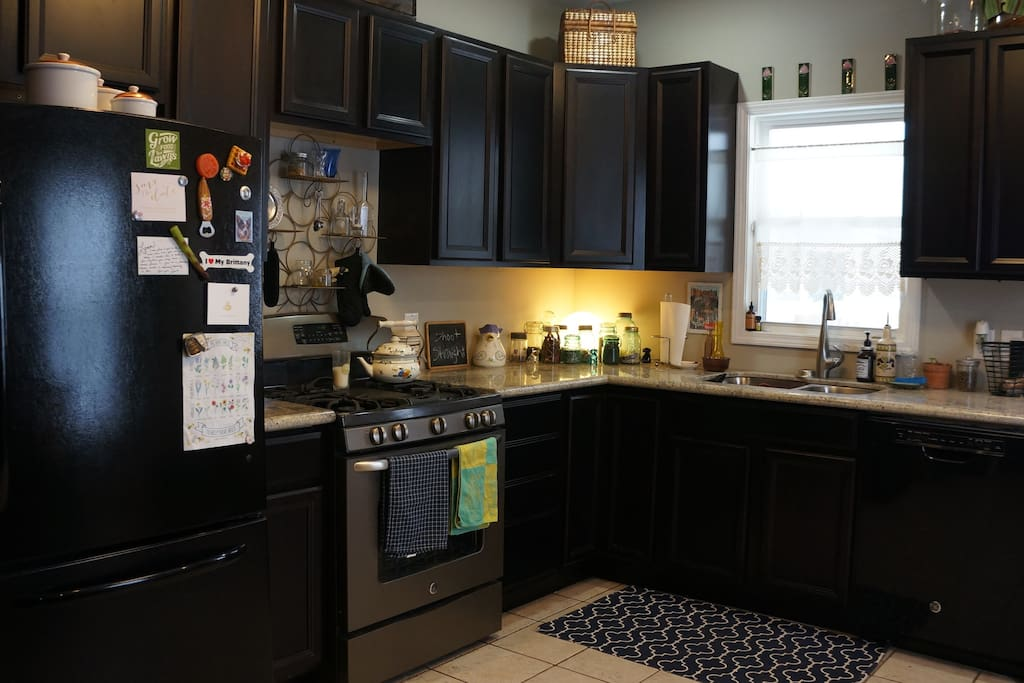 Gourmet, eat-in kitchen featuring ample counter space.