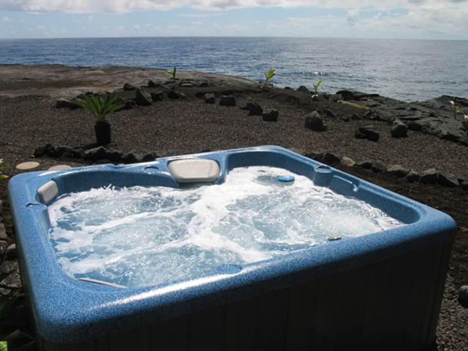 Soak in the hot tub while gazing at the ocean after a day of adventuring