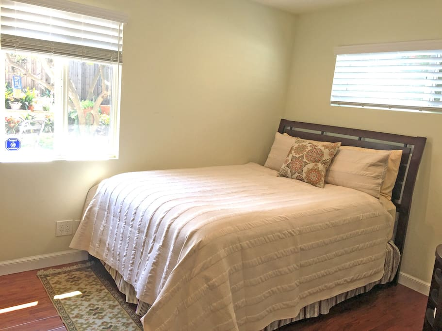 queen size bed in your bedroom with window looking out onto patio