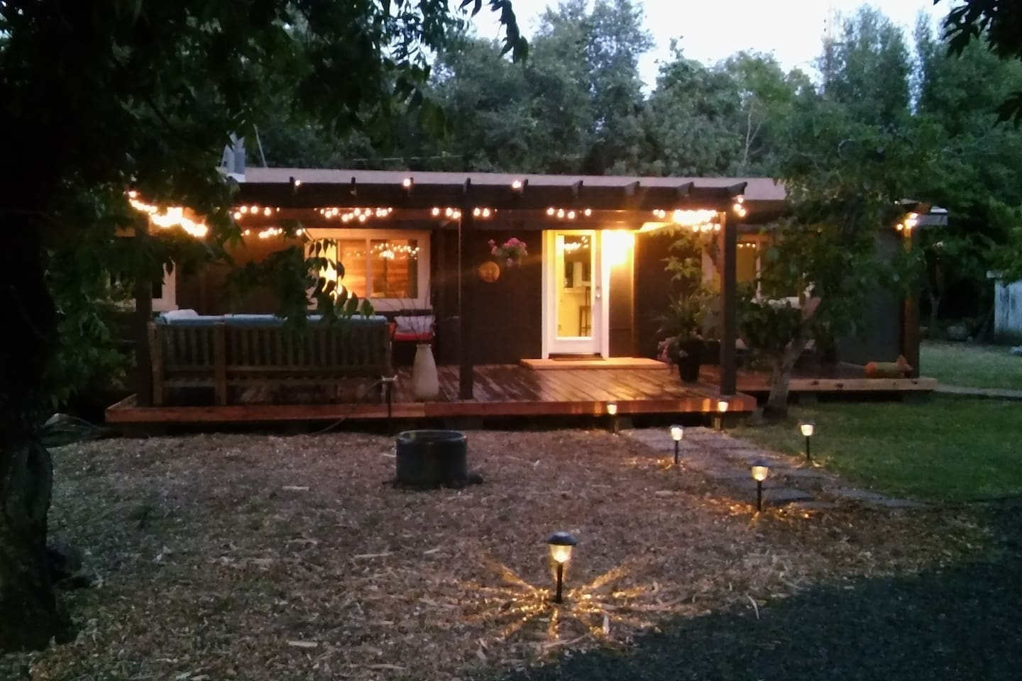 Inviting front entry and deck of Guest house at Bidwell Park . . . evening under the lights, ample seating and BBQ