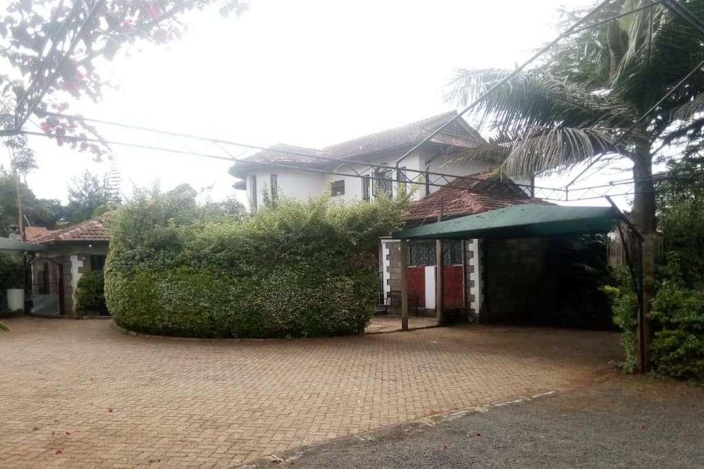 This is the main entrance to our compound. We have an ample parking space, mature gardens where with resting seats for our guest.