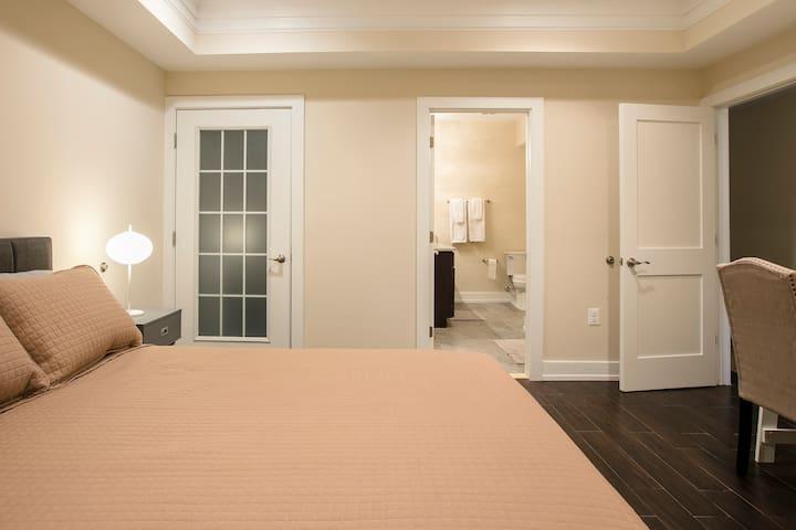 Bedroom #2 overview of bed, patio door and full two zinc bathroom