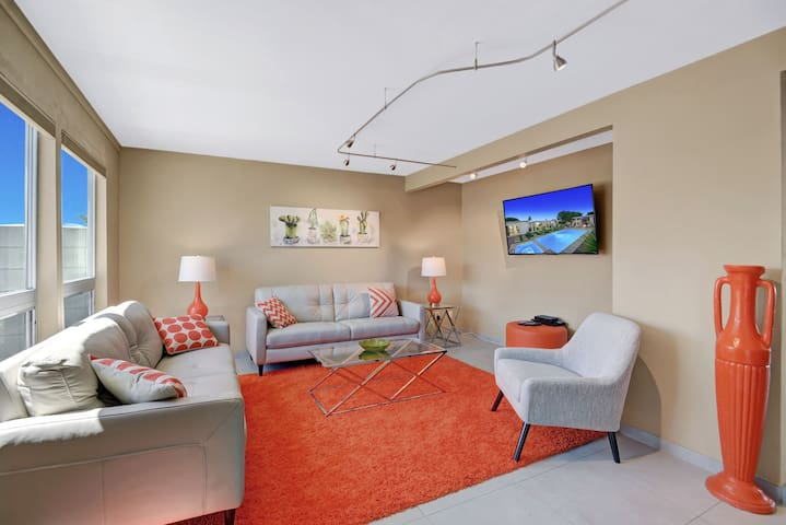 Adorned with modern art and decor, the living area has 2 sofas and a stylish armchair.