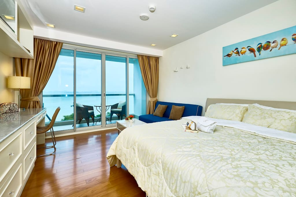 Studio room with brand new furnishings, and glass balcony rail for unobstructed sea view.  Black-out UV curtains will block the sun completely if you want to sleep in late.