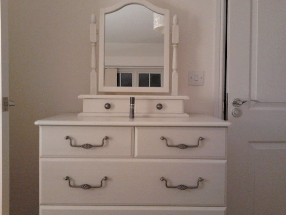 Empty chest of drawers for guest use