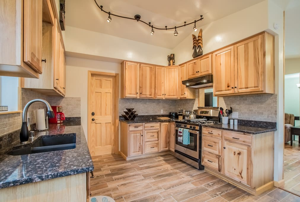 Enjoy the gorgeous wood cabinets and granite countertops surrounding the new appliances in this kitchen