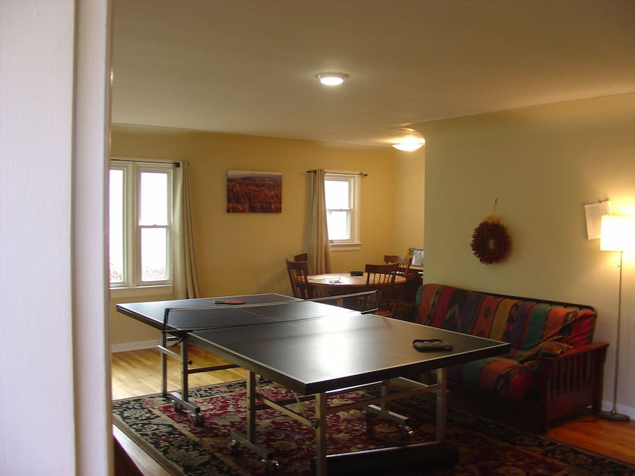 living room, shared,  usurped by ping pong table