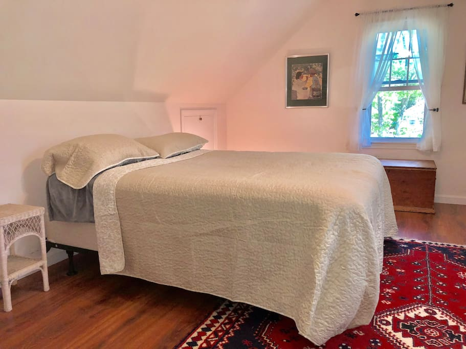 Bedroom (#1).  Queen & two single beds.  Large, with Oriental rug.