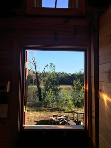 The view out the barn-style door is peaceful and relaxing