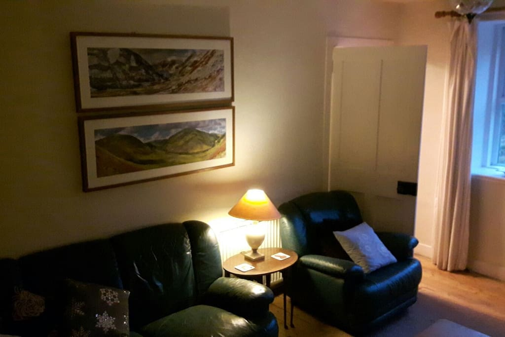 Comfy chairs, great photos and artwork around the house.