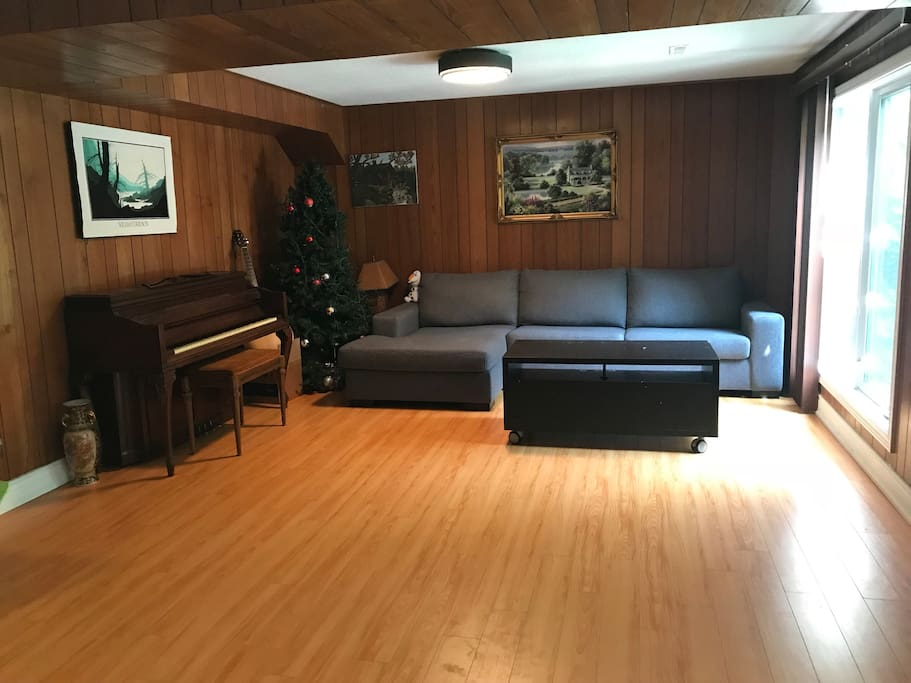 Living room  with dinning table,piano,sofa set,mini bar,wood fire place in the walk-out bsmt