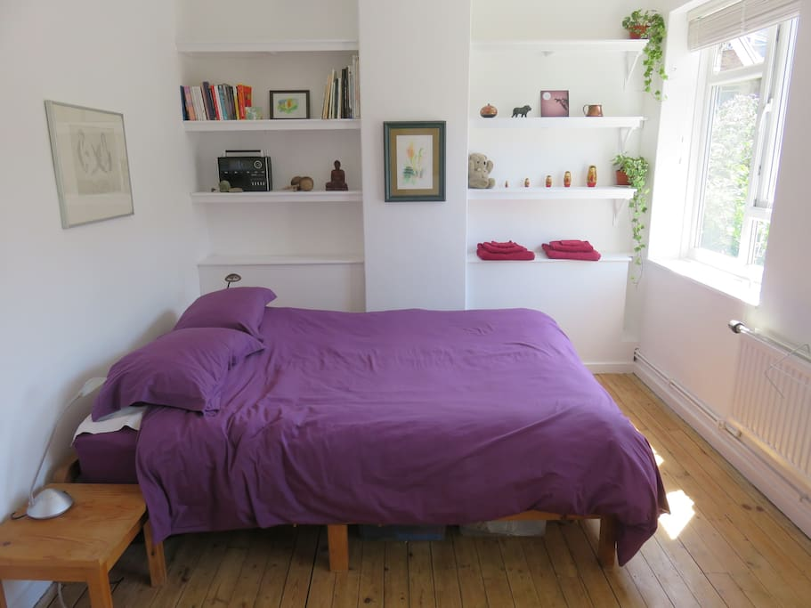 Master Bedroom upstairs, with comfortable king-size mattress and view to garden