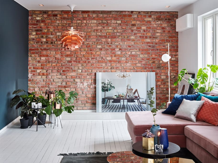 Living room with a cool brick wall.
