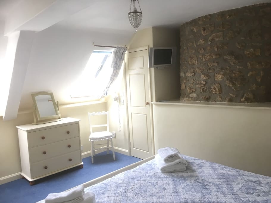 Double bedroom with the original stone chimney breast....