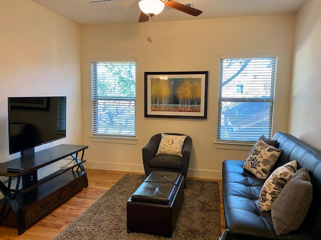 Open living space, with flat-panel LCD (includes TV and Amazon Firestick). Sofa bed couch.