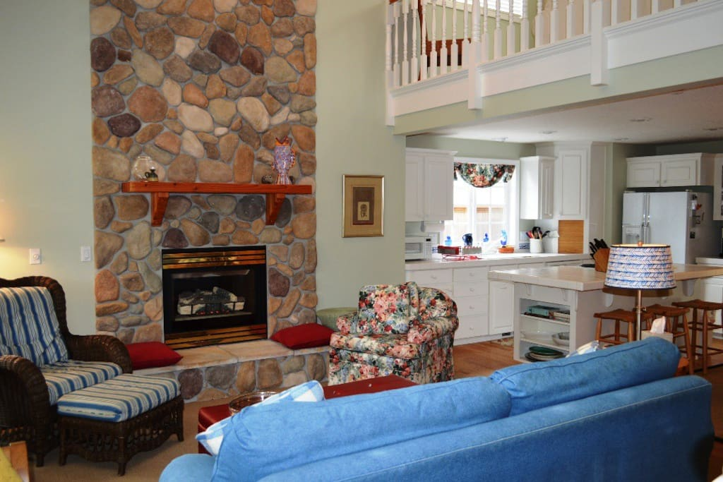 Lower level open living area with a gas fireplace-open to kitchen and dining area