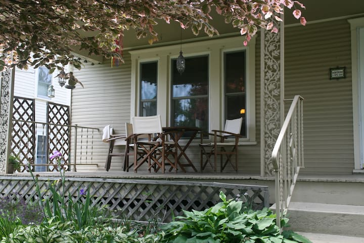 Sip a tasty beverage on our front porch!