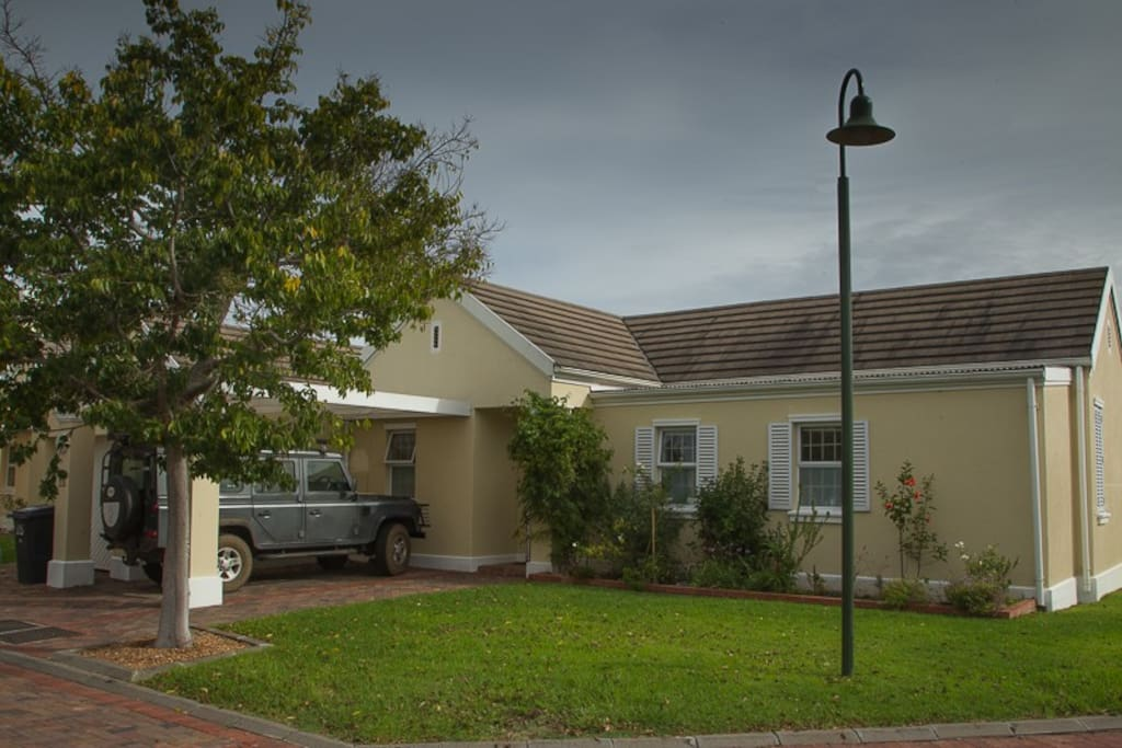 Front lawn, great for picnic's. Car port for 1 plus visitors parking for 1.