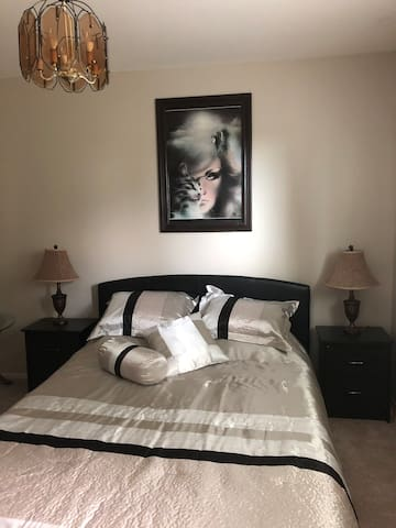 Bedroom bed -queen with two bed tables with 2 draws