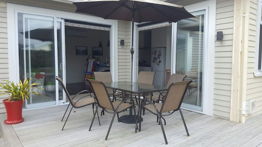 Glass doors slide all the way back to allow for excellent indoor-outdoor flow.