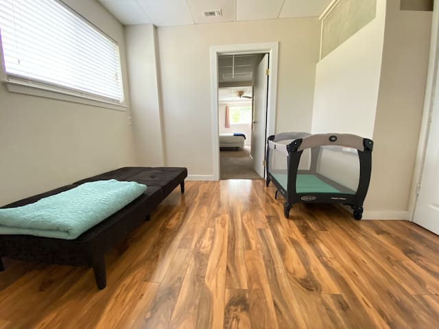 Bonus room is accessible thru the downstairs bedroom or from the exterior sunroom. The second futon, pack n play and air mattress are found in this space.