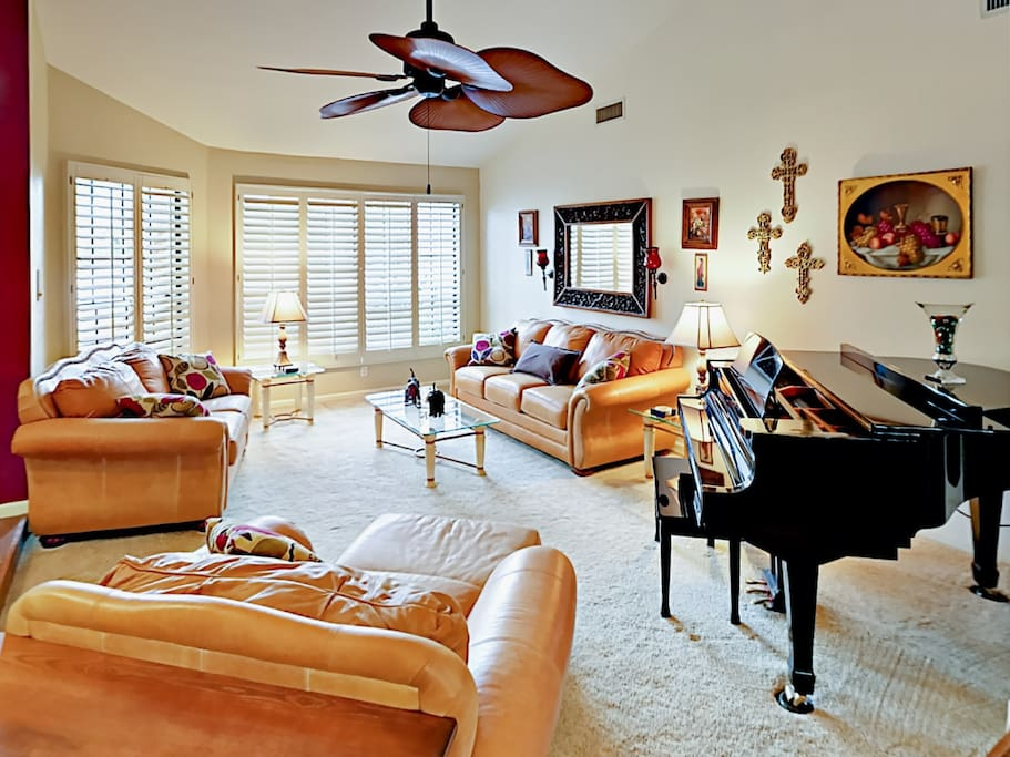 The baby grand piano is surrounded by comfortable seating for in-home concerts!