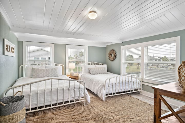 This bedroom has two queen-size beds and gorgeous views of the canal.