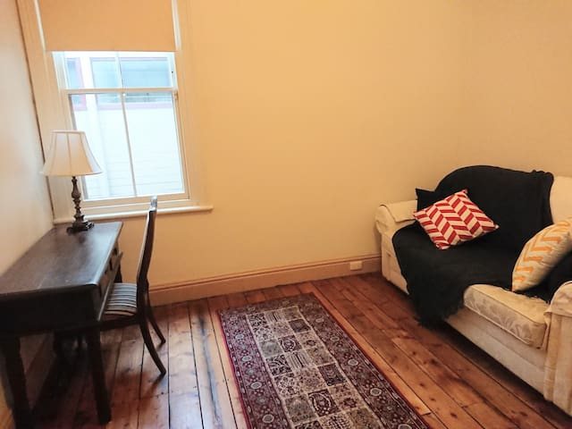 Study/ second bedroom with fold out couch
