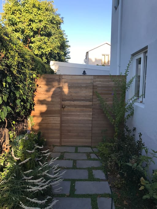 Wooden fence and gate provide complete privacy from the main house, and cottage is set securely back from the road.