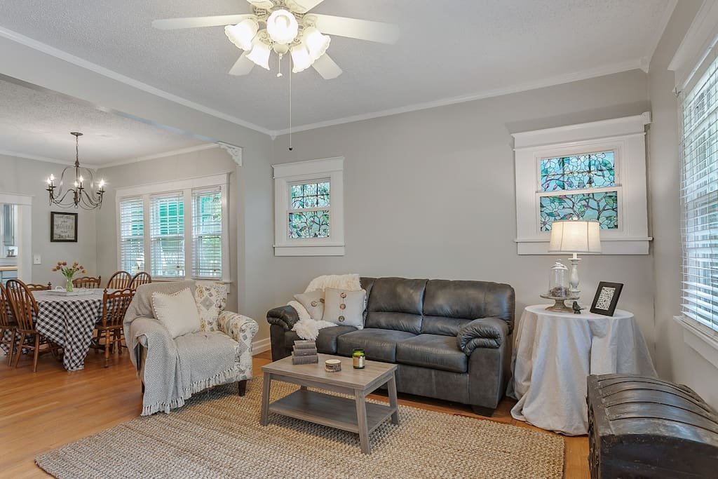 Open layout living room/dining room with plenty  of seating to relax, play games or watch a movie