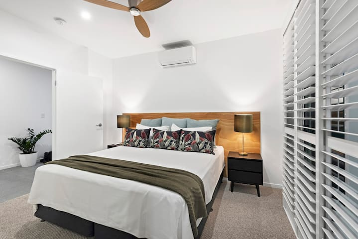 Master bedroom has a king size bed and luscious pillows to sink into for that perfect night sleep.  Large sliding doors give access to the garden area and plantations shutters will give the blockout needed to sleep in late.