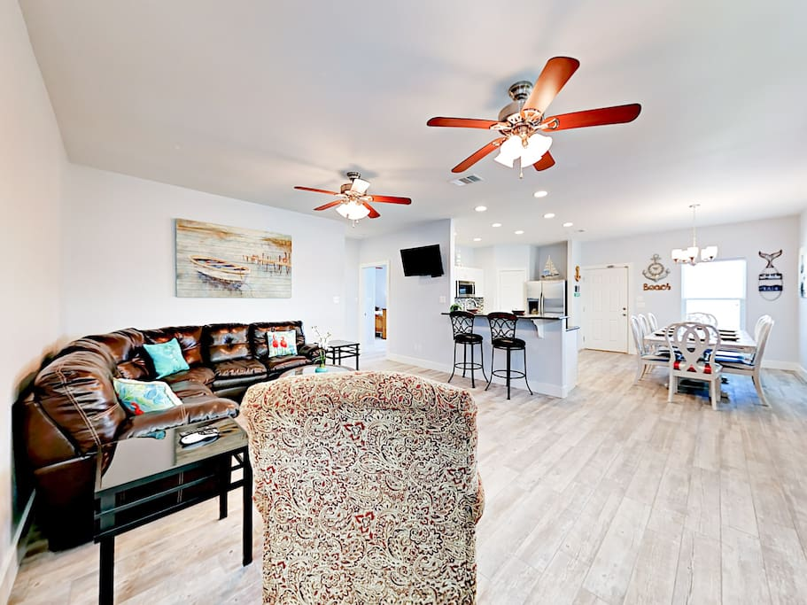 The stylish open living area features hardwood floors, as well as brand-new furnishings and decor.