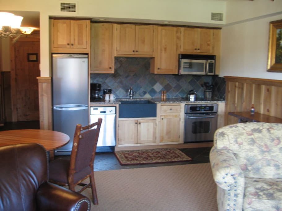 Fully equipped kitchen with custom alder wood cabinetry and granite countertops.