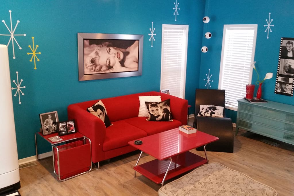 1950's Retro entertainment room. Has a small couch, chaise lounge and retro table with 4 chairs. This room also has an old working fridge, candy bar,popcorn maker and record player. Perfect for movie or board game nights! This room also backs into the gorgeous landscaped backyard.