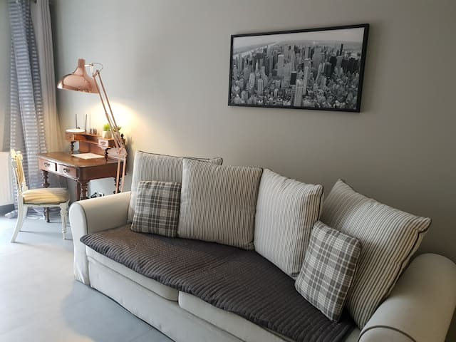 This is a real place where you can chill out. Comfy Sofa with an old cabinet ...