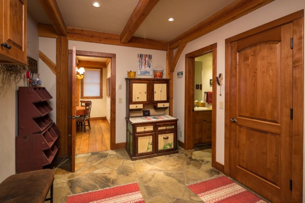 Spacious mud room with ample storage, access to a half bathroom
