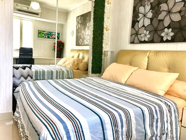 Queen bed with fresh linen, bedcover and pillow