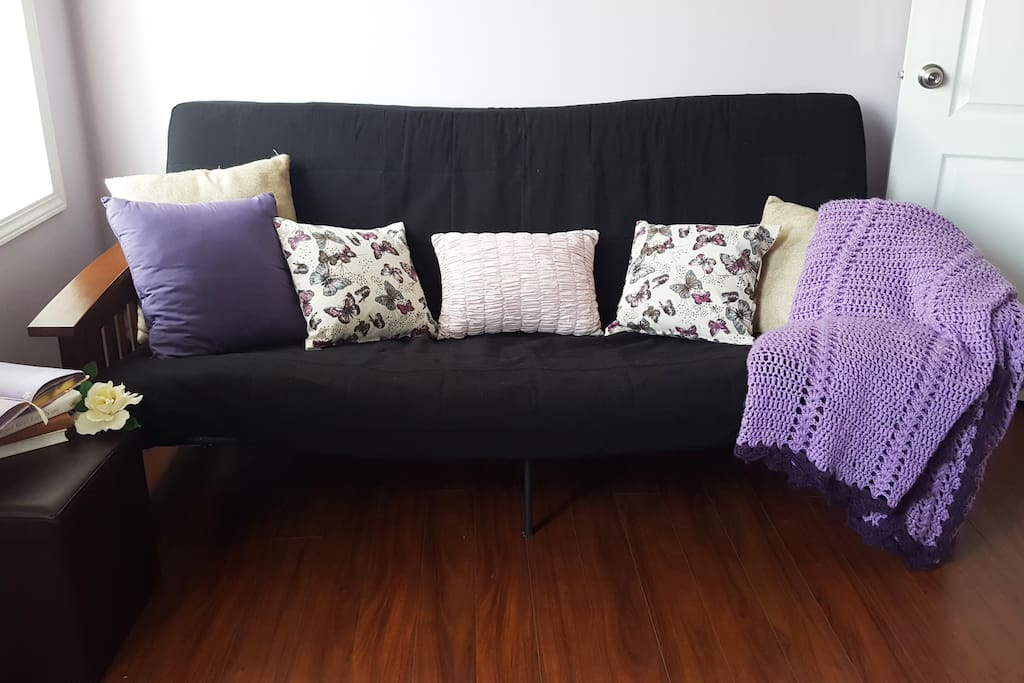 Relax with a book on the cozy futon