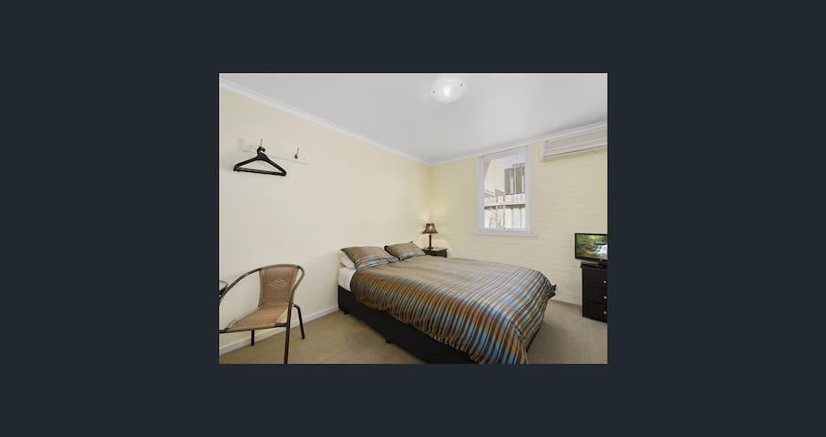 Newport Lodge Queen Bedroom with Shared Bathroom