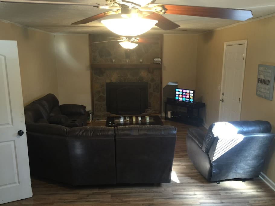 Comfortable living room with fireplace and tv