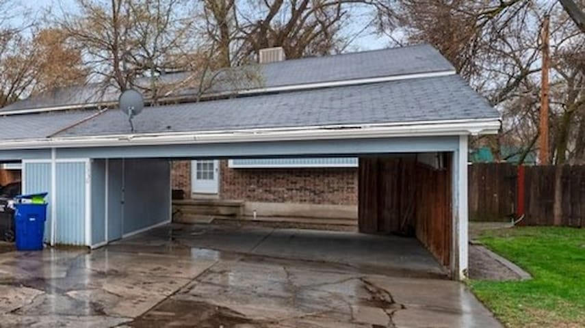 2 Car Carport with additional off street parking in long driveway.