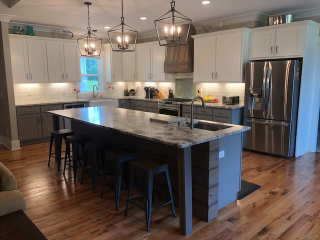 Large, fully stocked open kitchen with bar seating for 6. Opens to family room. Gas range and additional electric oven, drawer microwave, dishwasher, large fridge and two sinks.