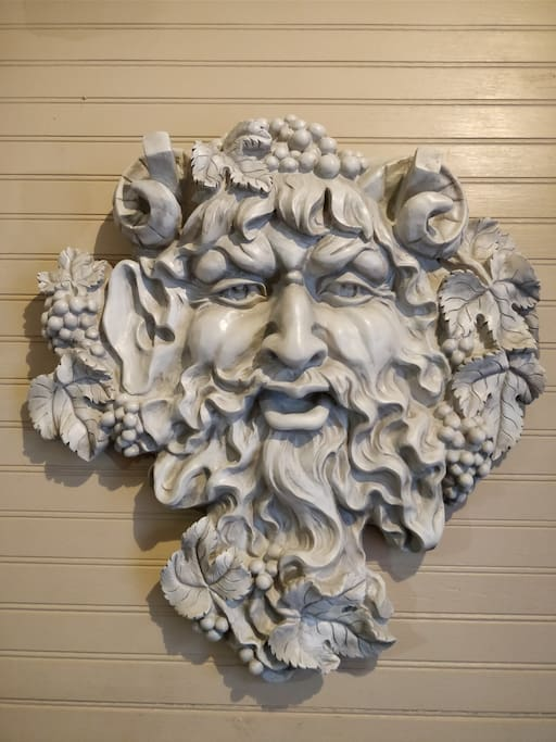 Greek God Bacchus will welcome you at the door