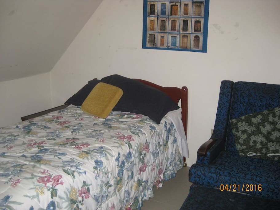 private bedroom with two single beds