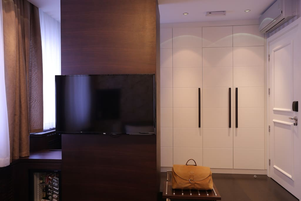 Presidential Suite TV and Storage Area