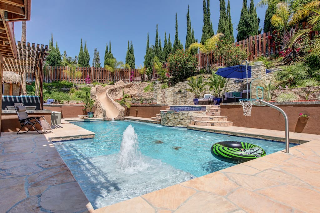Huge pool and spa with several water features including slide and diving board!!