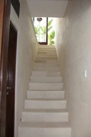 A stone stairway joins the two levels. Lockable doors ensure utmost privacy if desired.